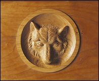 Wolf's head carving